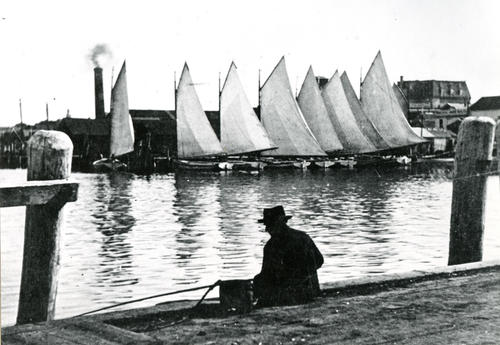 Catboats at wharf, Newport