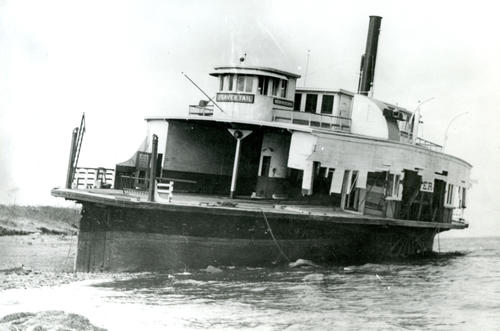 Beaver Tail (Ferryboat) ashore, north end of Jamestown after 1938 Hurricane