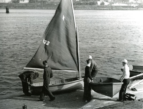 Brown University students launching sailboats