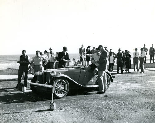 Officials check timing before antique car race