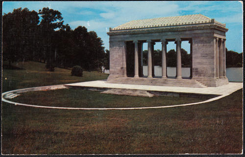 "The Benedict Memorial ""The Temple of Music"" on Cunliff Lake, given to the city by William C. Benedict in 1922.  Facing a natural amphitheatre, it is made of Vermont marble with Ionic columns, Roger Williams Park, Providence, R.I."