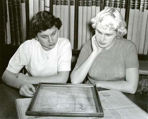 Women with Framed Document