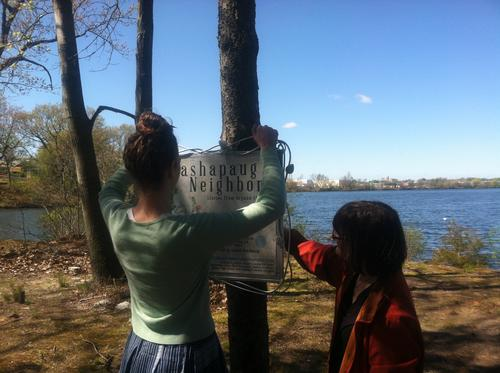 Installing a sign at Mashapaug Pond