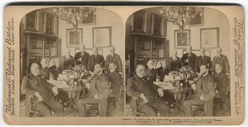 President McKinley sits at the head of the Cabinet Desk