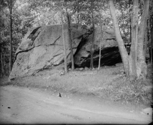 Boulder along a dirt road