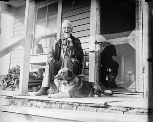 Man and dog on a porch